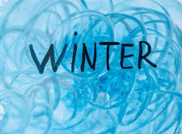 Fundo de inverno em aquarela. ilustração em aquarela de arte abstrata com a inscrição inverno em tons de azul