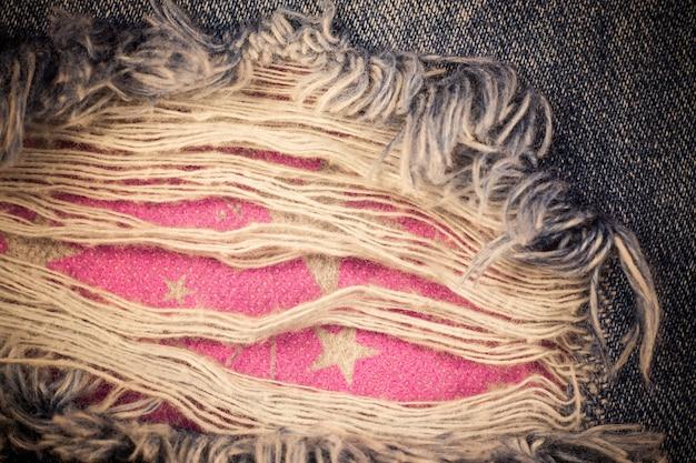 Fundo de jeans velho rasgado