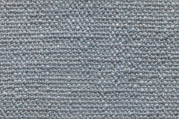 Fundo de lã tricotado azul com um padrão de pano macio e fofo. textura de closeup de têxteis.