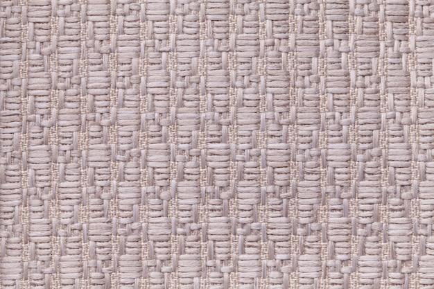 Fundo de lã tricotado marrom com um padrão de pano macio e fofo. textura de closeup de têxteis.