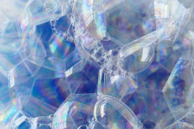 Fundo de macro de espuma de sabão. textura azul de close-up de espuma de sabão. espuma de banho. facilidade.luminosidade e arejamento.