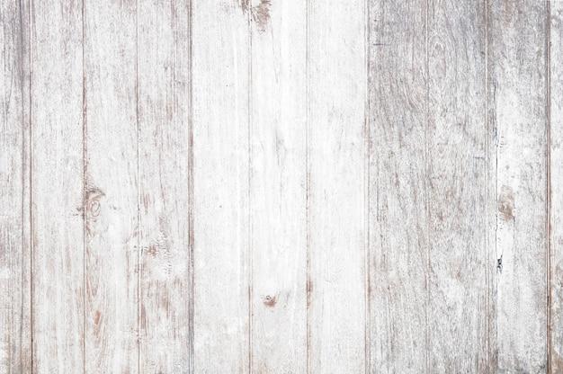 Fundo de madeira branco do vintage - prancha de madeira resistida velha pintada na cor branca.