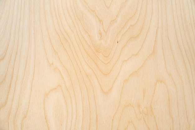 Fundo de madeira compensada de textura de madeira clara. vista de mesa rústica, configuração plana.
