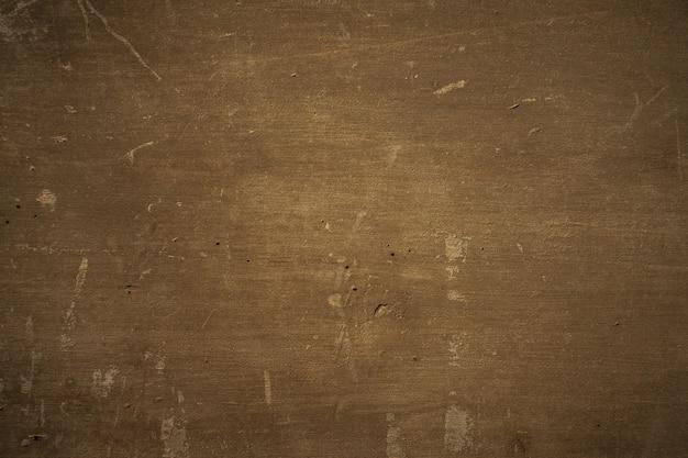 Fundo de madeira compensada marrom escuro.