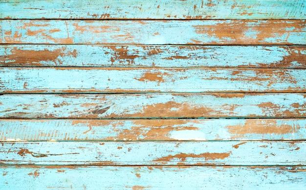 Fundo de madeira da praia do vintage - prancha de madeira resistida velha pintada na cor azul.