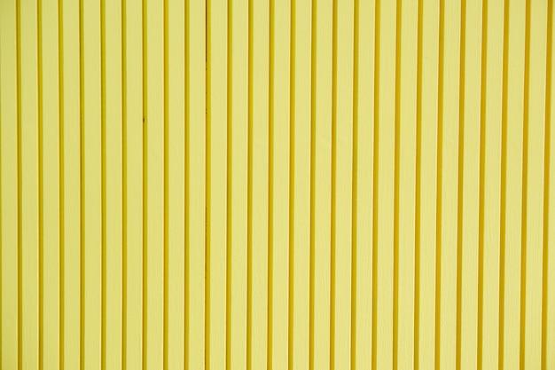 Fundo de madeira de parede amarela