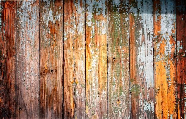 Fundo de madeira de velhas placas cinza com tonalidade laranja