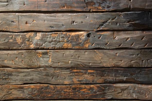 Fundo de madeira de velhas pranchas carbonizadas de textura perfeita com