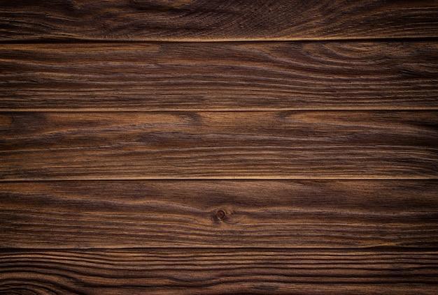 Fundo de madeira escuro abstrato, estilo de tom vintage.