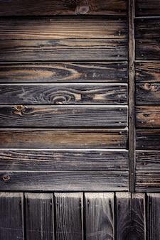 Fundo de madeira gasto escuro velho.