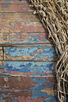 Fundo de madeira grunge com rede de pesca