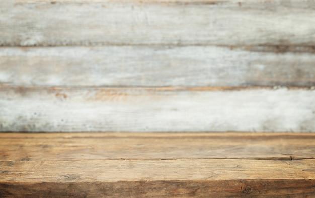 Fundo de madeira para a colocação de bens em primeiro plano