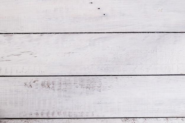 Fundo de madeira rústico branco. espaço para texto. brincar. fundo abstrato