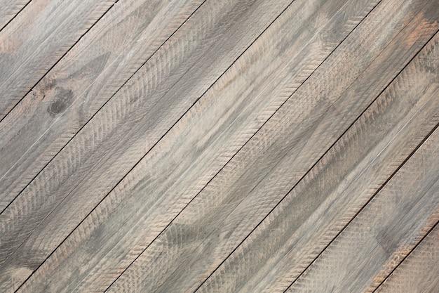 Fundo de madeira rústico cinza. orientação das bordas diagonais