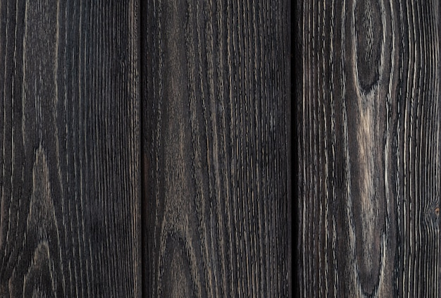 Fundo de madeira rústico. placas de cor cinza. espaço para texto.