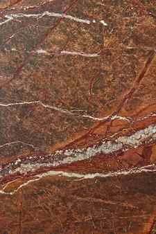 Fundo de mármore texturizado abstrato de pedra com veios brancos e vermelhos, copie o espaço para a sua criatividade. fundo natural para decoração de interiores.