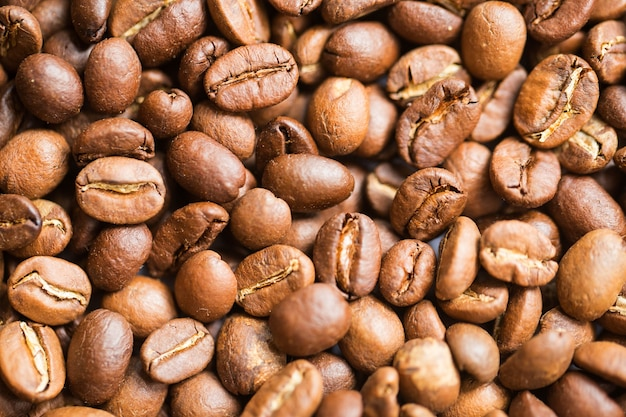 Fundo de matéria-prima de grãos de café.