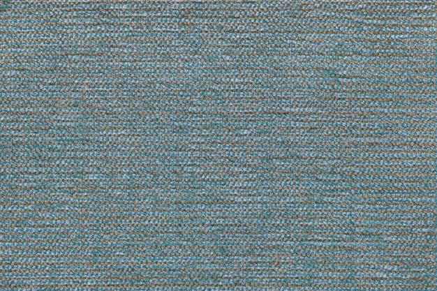 Fundo de matéria têxtil do céu azul com teste padrão quadriculado, close up. estrutura da macro de tecido.
