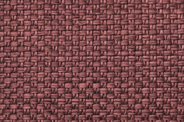 Fundo de matéria têxtil marrom com padrão quadriculada, closeup. estrutura da macro de tecido.