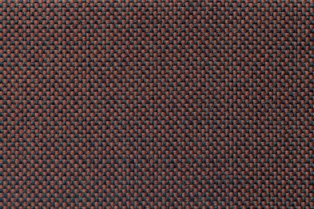 Fundo de matéria têxtil marrom com teste padrão quadriculado, close up.