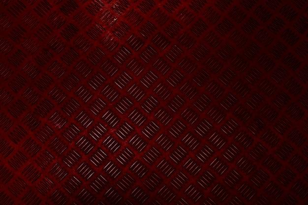 Fundo de metal abstrato vermelho escuro com um design de textura de xadrez