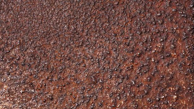 Fundo de metal enferrujado com manchas de ferrugem manchas de ferrugem rysty corrosão ferrugem em metal antigo