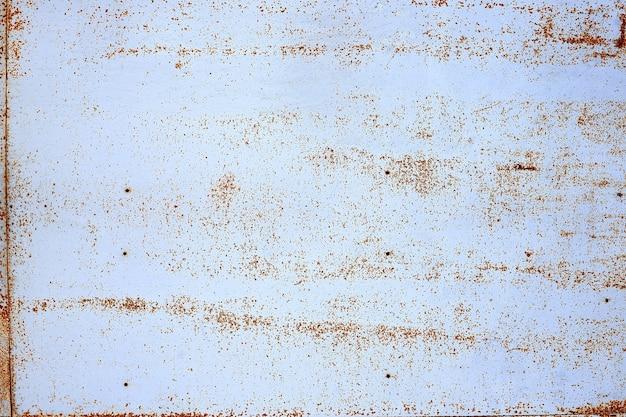 Fundo de metal enferrujado grunge. padrão abstrato de lata de aço enferrujado.