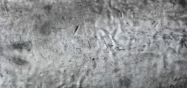 Fundo de metal escuro, vista panorâmica de uma textura de aço inoxidável