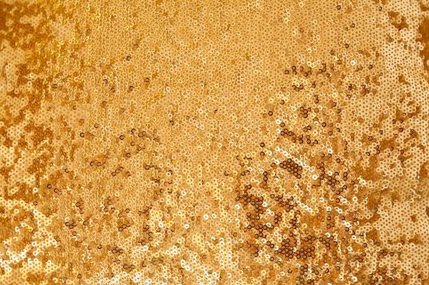 Fundo de natal, ano novo e textura de tecido bordado com lantejoulas