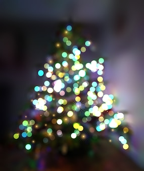 Fundo de natal com árvore desfocada e luzes