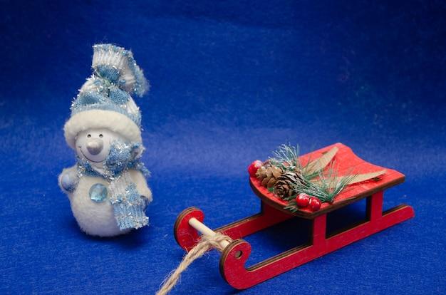 Fundo de natal com estrelas e flocos de neve boneco de neve
