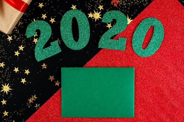 Fundo de natal com números verdes e cartão de felicitações
