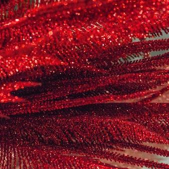 Fundo de natal com textura de glitter vermelho