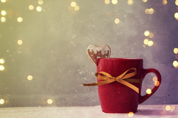 Fundo de natal com uma xícara de chá
