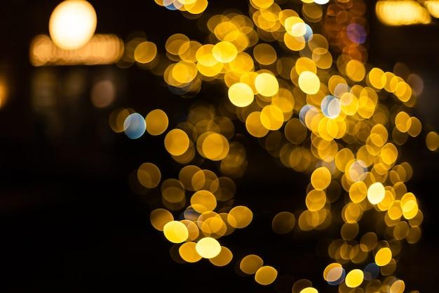 Fundo de natal. fundo desfocado dourado do brilho do feriado do sumário. bokeh borrado