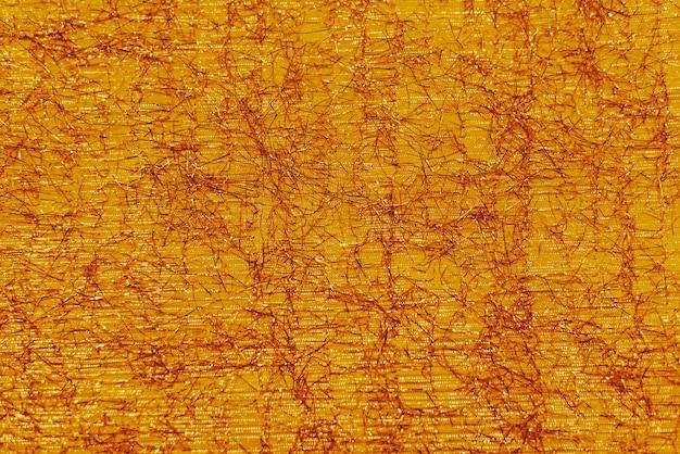 Fundo de natal laranja brilhante festivo com cordas brilhantes de lurex