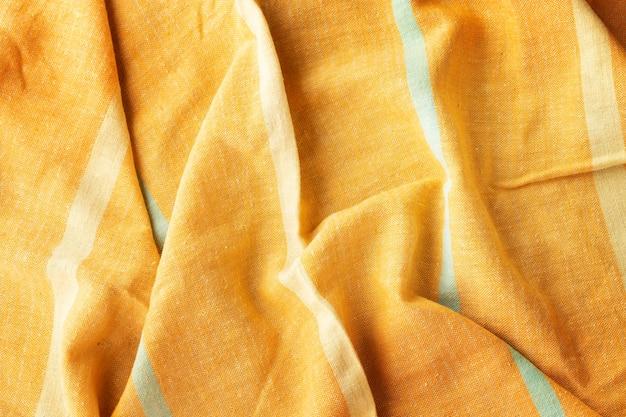 Fundo de pano listrado de linho amarelo vintage