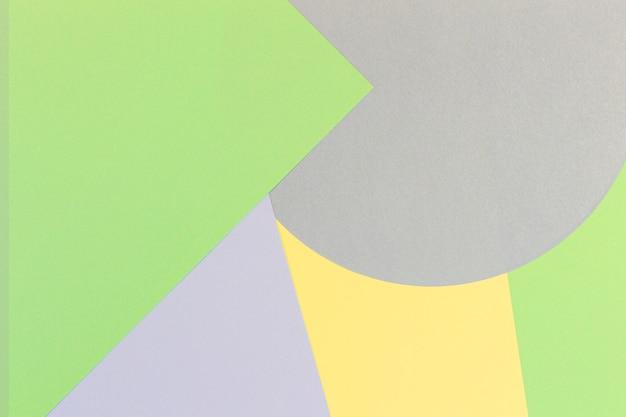 Fundo de papel abstrato com formas geométricas mínimas e linhas nas cores verde pastel, azul claro e amarelo
