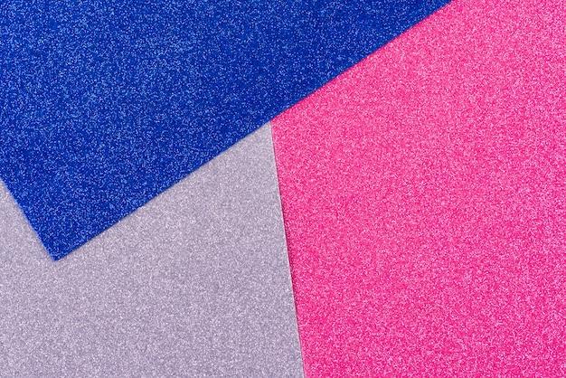 Fundo de papel abstrato geométrico brilhos. cores da tendência prata rosa azul.
