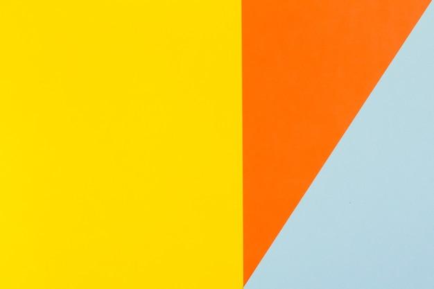 Fundo de papel amarelo azul e laranja