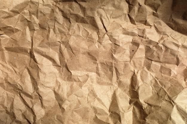 Fundo de papel amassado de embrulho marrom. fechar-se