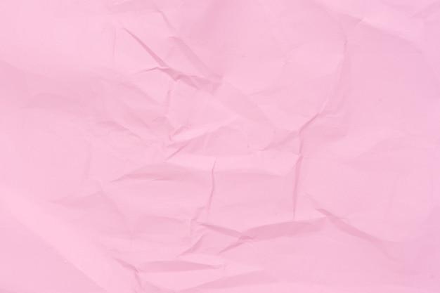 Fundo de papel amassado rosa. layout para design