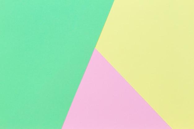 Fundo de papel de cor amarela e rosa pastel de forma geométrica abstrata
