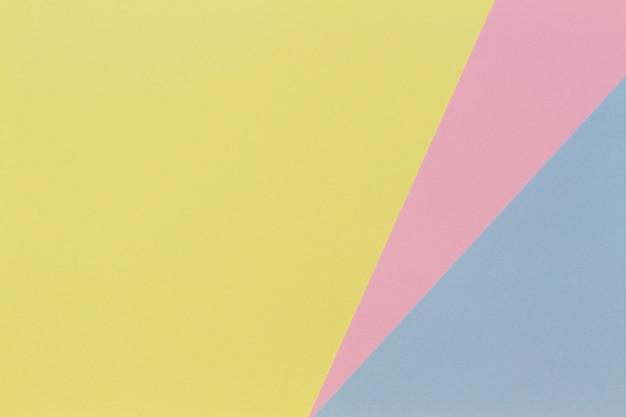Fundo de papel de cor pastel de forma geométrica abstrata azul, rosa e amarelo