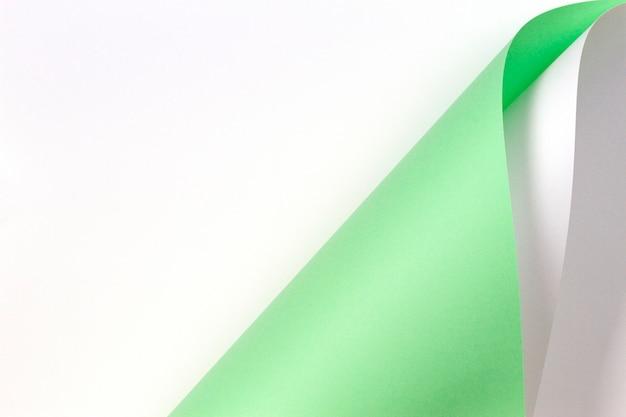 Fundo de papel de cor verde e branco pastel de forma geométrica abstrata