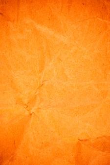 Fundo de papel laranja de embalagem amassado texturizado.