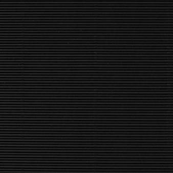 Fundo de papel preto ondulado em branco