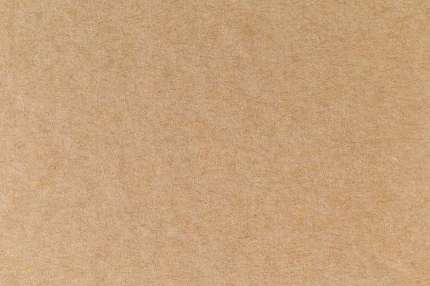 Fundo de papelão textura de folha de papel kraft reciclado eco marrom.