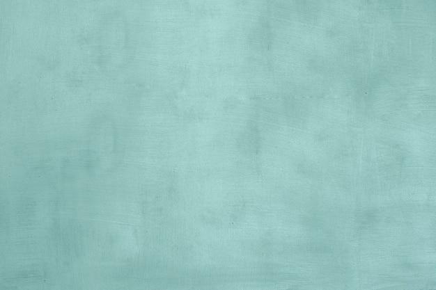 Fundo de parede azul velha, parede de concreto rachada