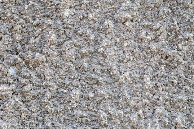 Fundo de parede de concreto sujo de superfície closeup